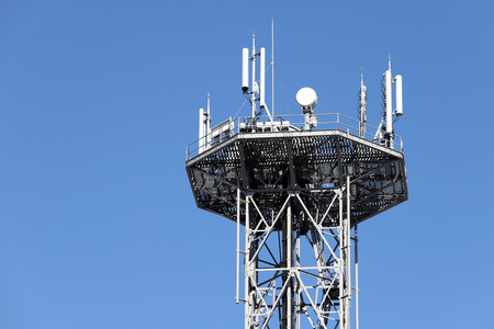 View of communications tower against blue sky