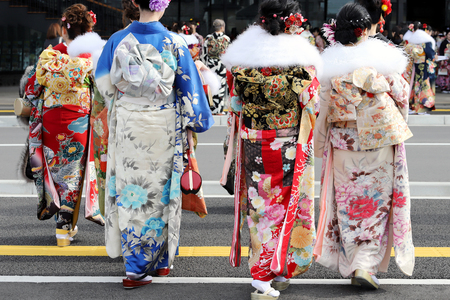 Young Japanese women wearing traditional kimono for the coming of age day celebration, they turn twenty (seijinsiki, seijinshiki) Stock Photo - 93532716