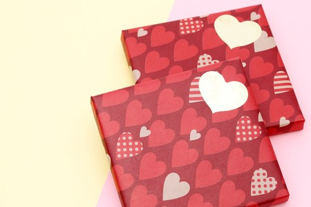 Valentines Day concept. Gift with bow on the yellow background Valentines gift box 写真素材
