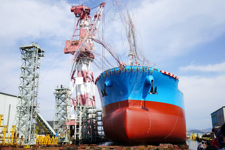 Newly built vessel during launching of the shipyard in Japan Фото со стока
