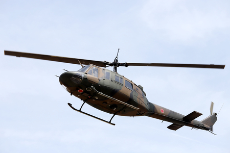 Japanese military helicopter in flight, Military helicopter flying Stock Photo