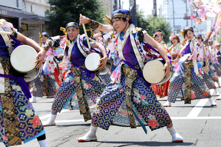KAGAWA, JAPAN-JULY 15 2018: Japanese performers dancing in the famous Yosakoi Festival, yearly free public event. Yosakoi is a unique style of Japanese dance event.
