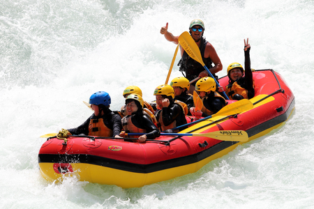 KOBOKE, TOKUSIMA, JAPAN - AUGUST 6, 2018: White water rafting on the rapids of river Yosino on August 6, 2018 in Koboke Canyon, Japan. Yosino River is one of the most popular among rafters in Japan.