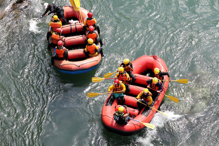 KOBOKE, TOKUSIMA, JAPAN - AUGUST 14, 2018: Water rafting on the rapids of river Yosino on August 6, 2018 in Koboke Canyon, Japan. Yosino River is one of the most popular among rafters in Japan.