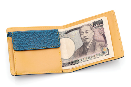 Leather wallet and ten thousand japanese yen on white background Imagens