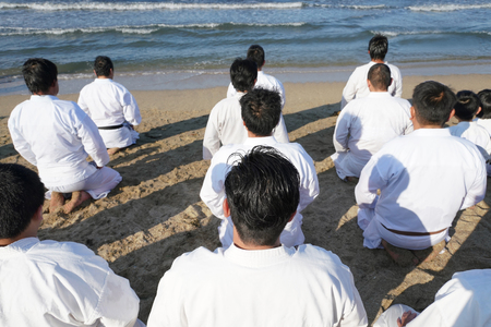 Japanese karate martial arts, spiritual sitting at the beach