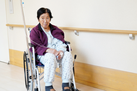 Senior or elderly woman patient on wheelchair so sad in hospital