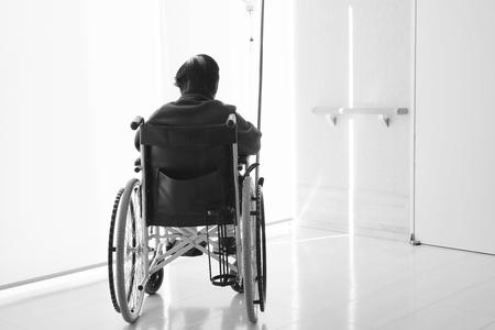 Senior or elderly woman patient on wheelchair so sad in hospital