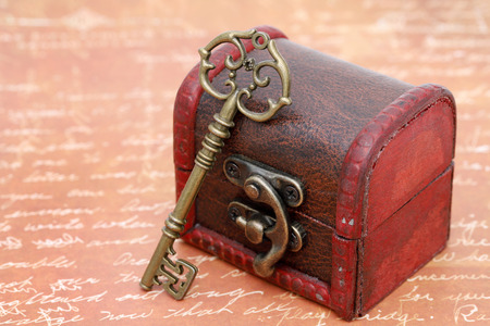 vintage key and old treasure chest on letter