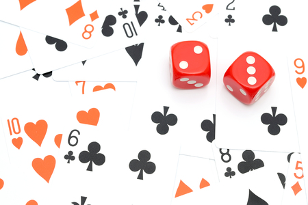 Playing cards and dice for game on white background