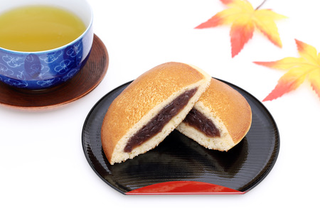 Dorayaki, Japanese confectionery on wooden tray on white background Stock Photo - 119716462