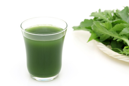 Aojiru, glass of green vegetable juice on white background