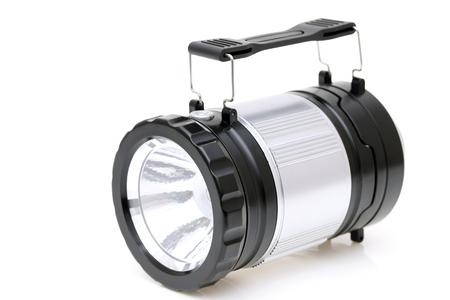 Electric led pocket flashlight on white background