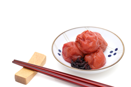 Japanese food, salted Umeboshi on white background
