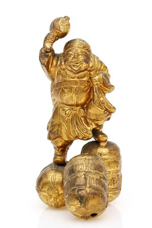 Statuette of Japanese daikoku god isolated on white background Stock Photo