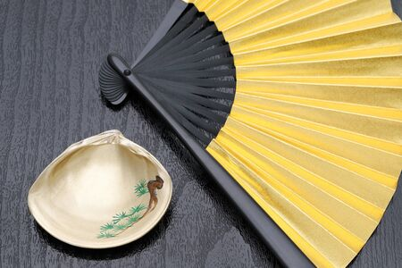 Japanese golden folding fan and gold painting seashell
