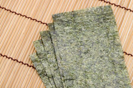 Japanese food, Nori dry seaweed sheets on bamboo background