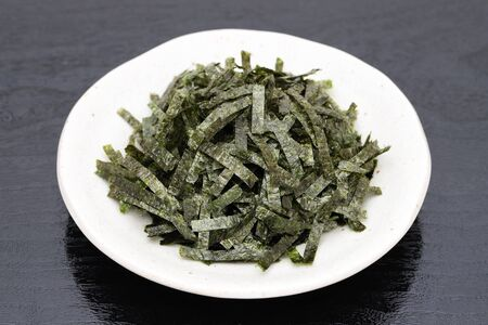 Japanese food, Nori dried seaweed on black background Stock Photo