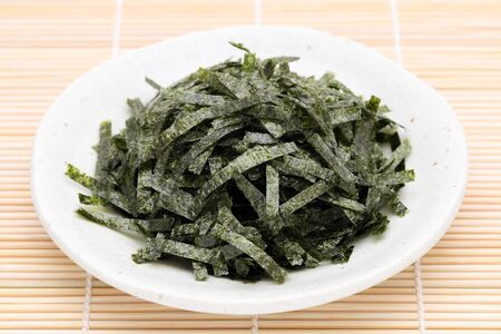 Japanese food, Nori dried seaweed on bamboo background