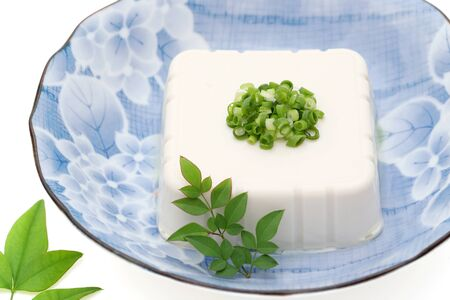 Japanese food, Japanese soft cold tofu in a bowl on white background 写真素材 - 129847255