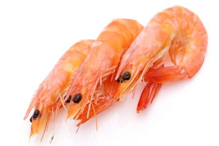red raw shrimps on a white background