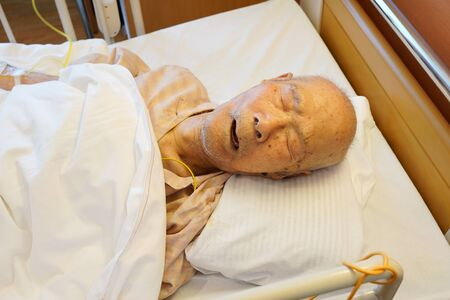 Japanese elderly man patient lying in bed sleeping