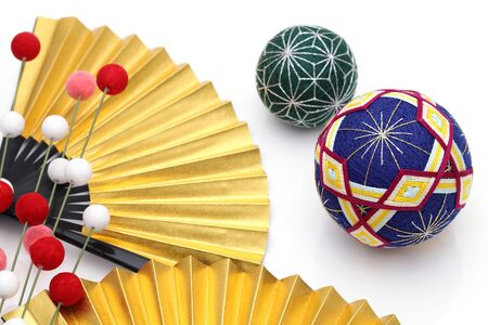 Japanese traditional colorful temari ball with golden folding fan