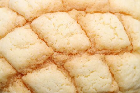 Close up of Japanese meronpan bread texture background