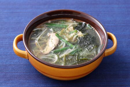 vegetable with pork soup in a dish on table