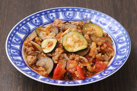 stir fry of vegetable with minced meat in a dish on table