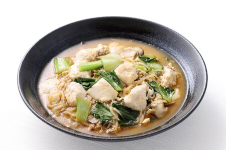 Chinese cuisine mapo tofu in a dish on white background