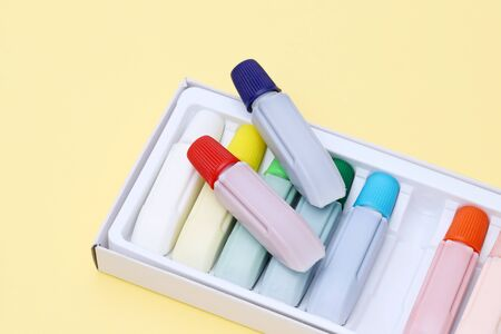 Tube of water color paint on yellow paper background