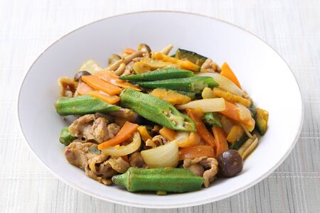 Vegetable stir fry in a plate on white background
