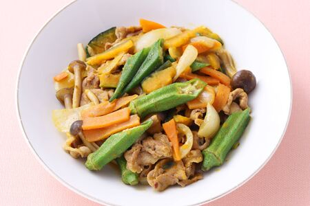 Vegetable stir fry in a plate on table