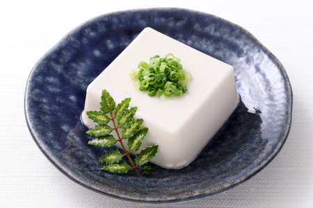 Japanese food, Japanese soft cold tofu in a bowl on white background Stock Photo