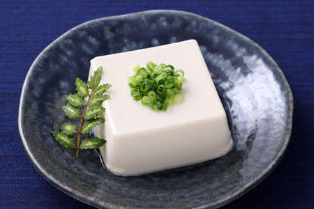 Japanese food, Japanese soft cold tofu in a bowl on dining table Stock Photo