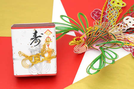 "Japanese wedding gift, traditional custom. It is written ""Kotobuki"" (meaning congratulations on marriage)"