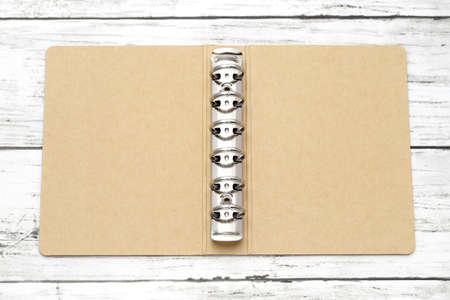 opened blank cover cardboard notebook with metal ring