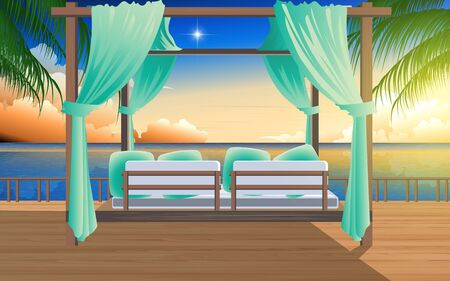Outdoor cabana bed on the wooden floor in resort at the beach in sunset