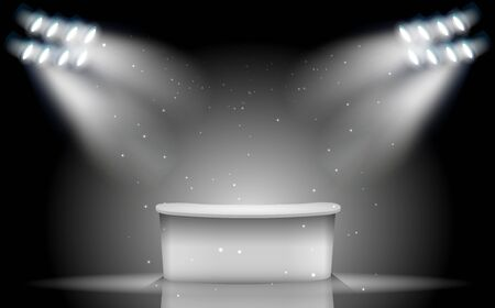 white table with white spotlight on the stage