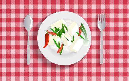 tofu in the white plate on the red tablecloth