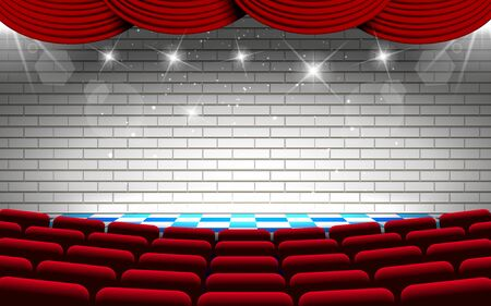 white brick wall on the stage with red chairs in the hall