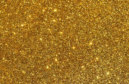 funkelt goldener Glitzer abstrakter Hintergrund Standard-Bild