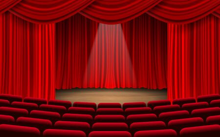 red chairs and red curtain on the stage in the hall