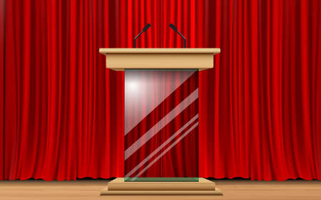 glass announcement podium and red curtain on the wooden stage