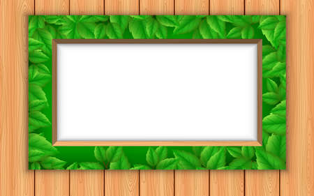 green leaf picture frame on the wooden wall 免版税图像