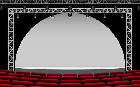 white stage with spotlight and red seats in the hall