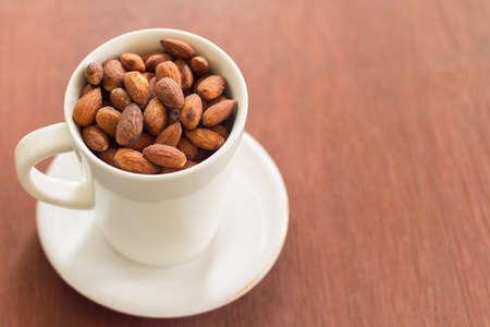 almonds in white ceramic glass photo