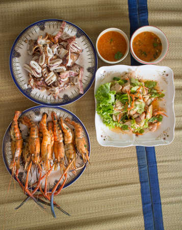 Seafood dinner from Prawns, Squids, Scallops (vintage color) photo