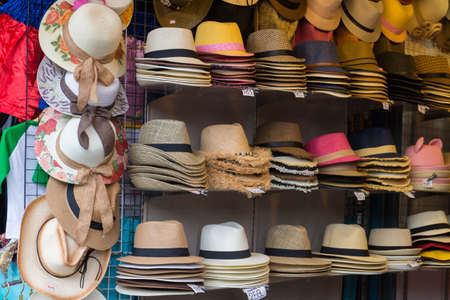 craftsmanship: Market stall with craftsmanship hats in straw hats for sale Stock Photo